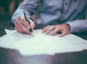 man in blue shirt drafting contract